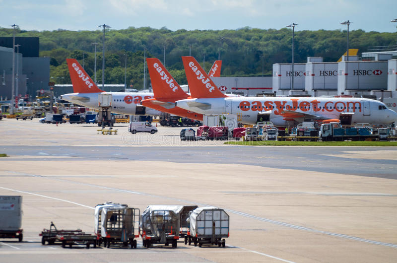 GATWICK, UK - APRIL 10: Easy Jet Airbus airplanes parked in Gatwick airport stock photography