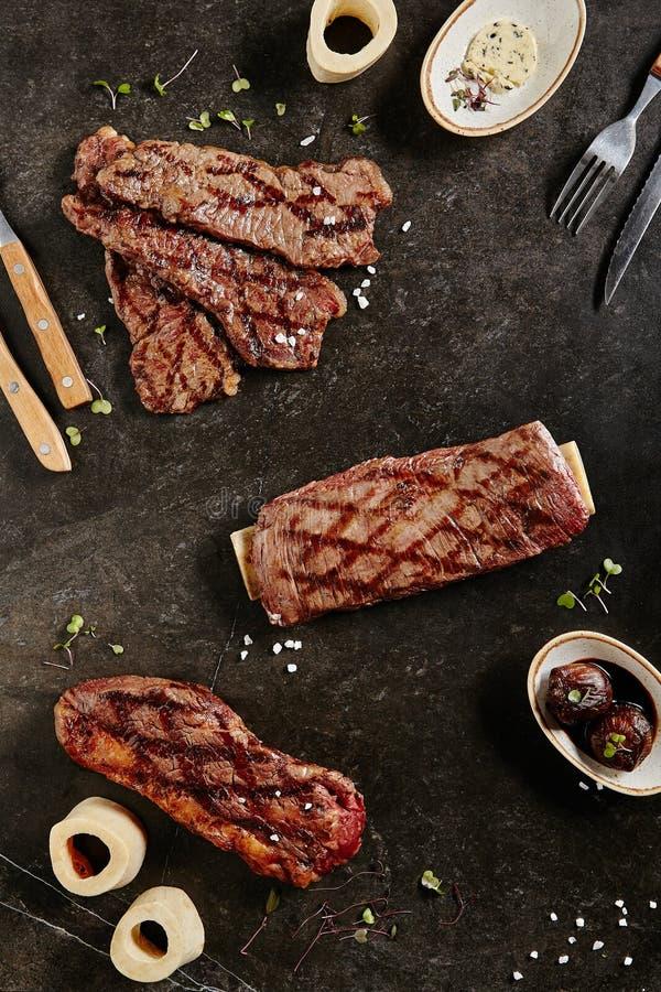 Gaucho Steak, Flank Steak and Tri-Tip Steak on Dark Backdrop royalty free stock photo