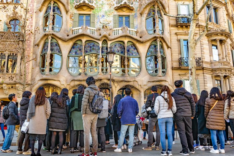 Gaudi Batllo House Building, Barcelona, Spain. BARCELONA, SPAIN, JANUARY - 2018 - Crowded watching batllo house, a famous gaudi masterpiece atchitecture located stock photos