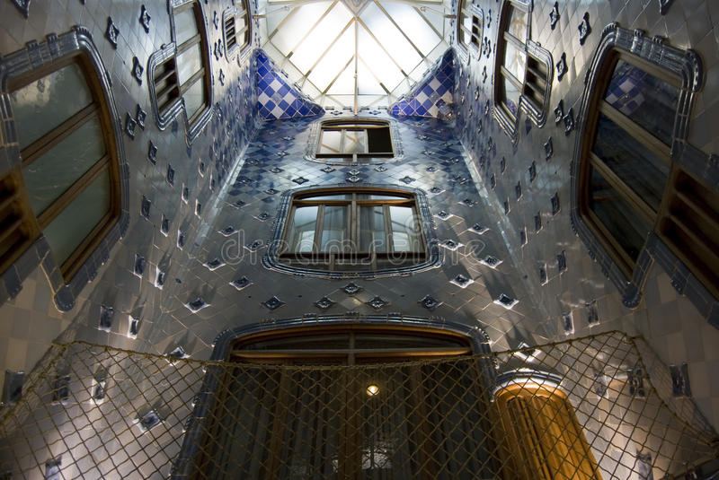 Gaudi's Casa Batllo'. Internal view of Casa Batllo', decoration with glazed tiles in all shades of blue, Barcelona, Spain. Architect Antoni Gaudi stock image