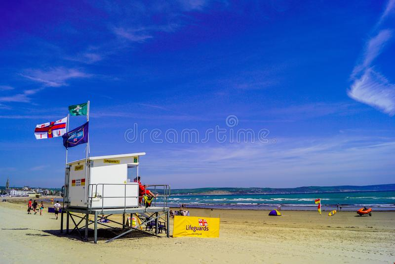 Gaurds di vita della spiaggia di Weymouth immagine stock libera da diritti