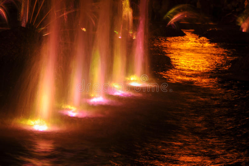 Gaussian blur. It is convenient for the designer. Fountain jet o. F fluid ejected upward from the pipe holes or the pressure force. Lumiere fountain. rhythmic stock image