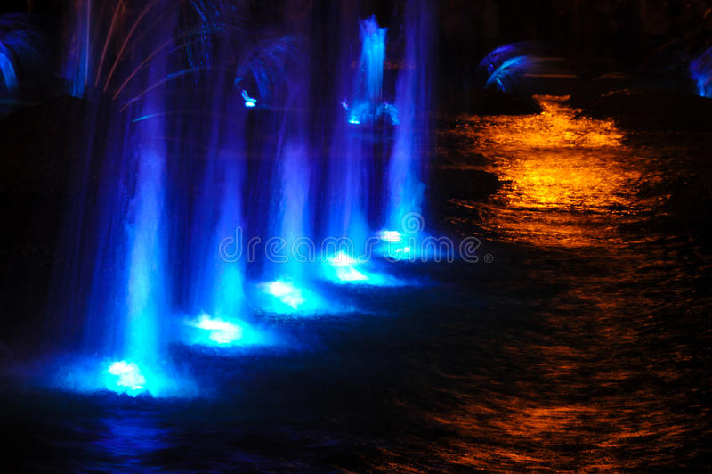 Gaussian blur. It is convenient for the designer. Fountain jet o. F fluid ejected upward from the pipe holes or the pressure force. Lumiere fountain. rhythmic royalty free stock photography