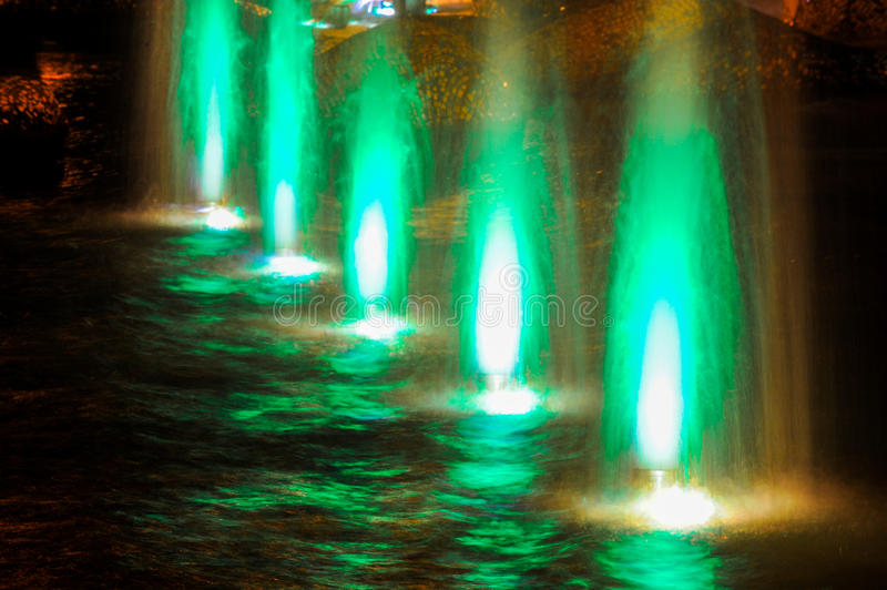 Gaussian blur. It is convenient for the designer. Fountain jet o. F fluid ejected upward from the pipe holes or the pressure force. Lumiere fountain. rhythmic stock photo