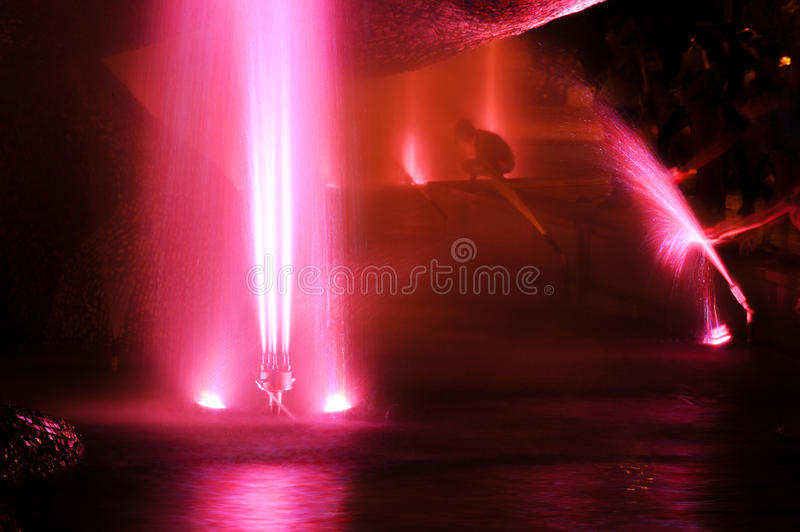 Gaussian blur. It is convenient for the designer. Fountain jet o. F fluid ejected upward from the pipe holes or the pressure force. Lumiere fountain. rhythmic royalty free stock image