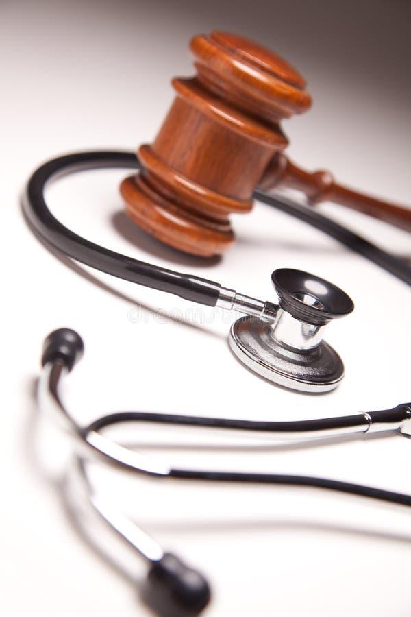 Free Gavel And Stethoscope On Gradated Background Stock Image - 12706671
