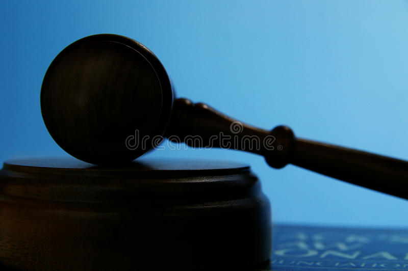Gavel on blue stock photo