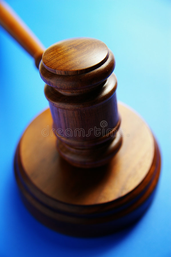 Gavel on blue. Wooden judge's gavel from above, on blue royalty free stock images