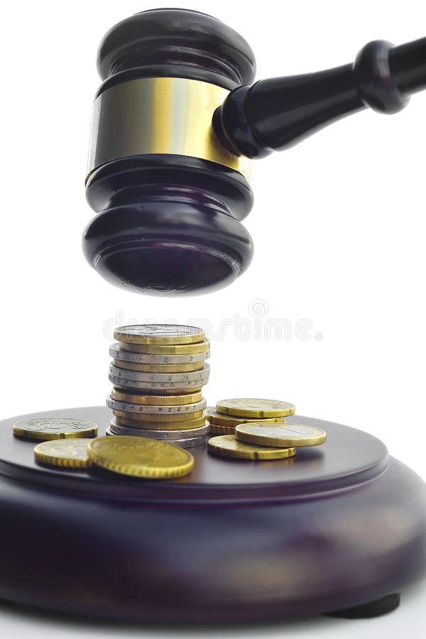 GAVEL WITH COINS ON THE BASE. A gavel with coins on the base stock images