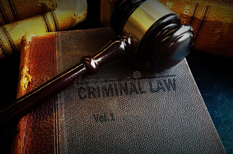 Gavel and Criminal Law books. Old Criminal Law books and court gavel royalty free stock image