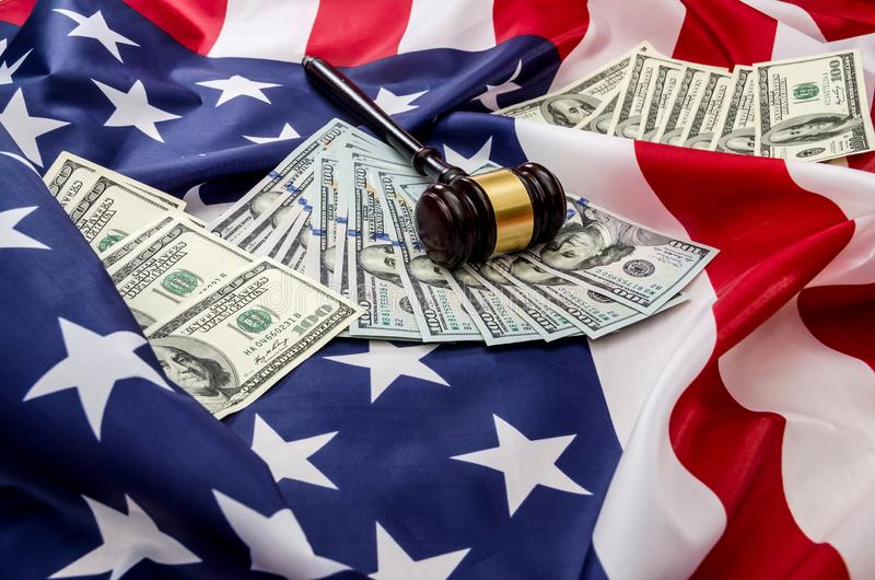 Gavel and dollars on usa flag. Background stock photo