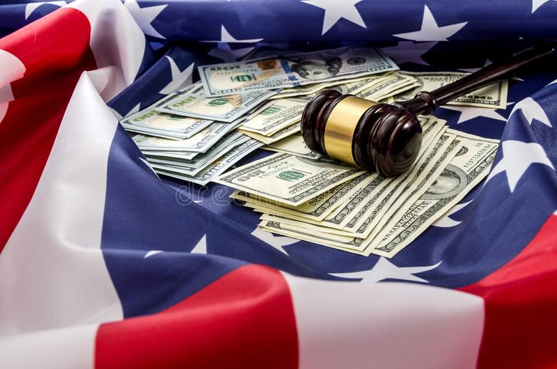 Gavel and dollars on usa flag. Background royalty free stock image