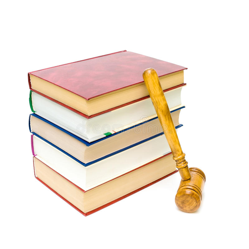 Gavel and five books isolated on white close-up. Wooden gavel and a stack of five books isolated on white close-up stock photo