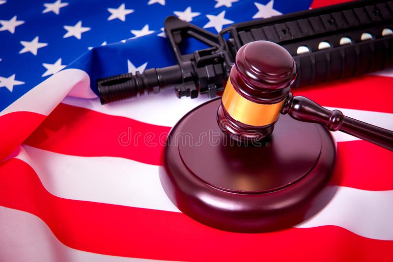 Gavel with gun on background of USA flag. stock photography