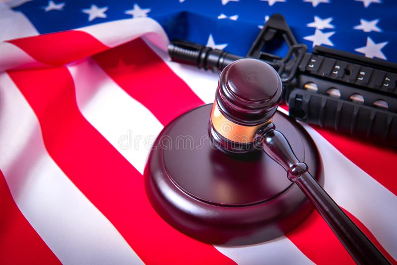 Gavel with gun on background of USA flag. stock photos