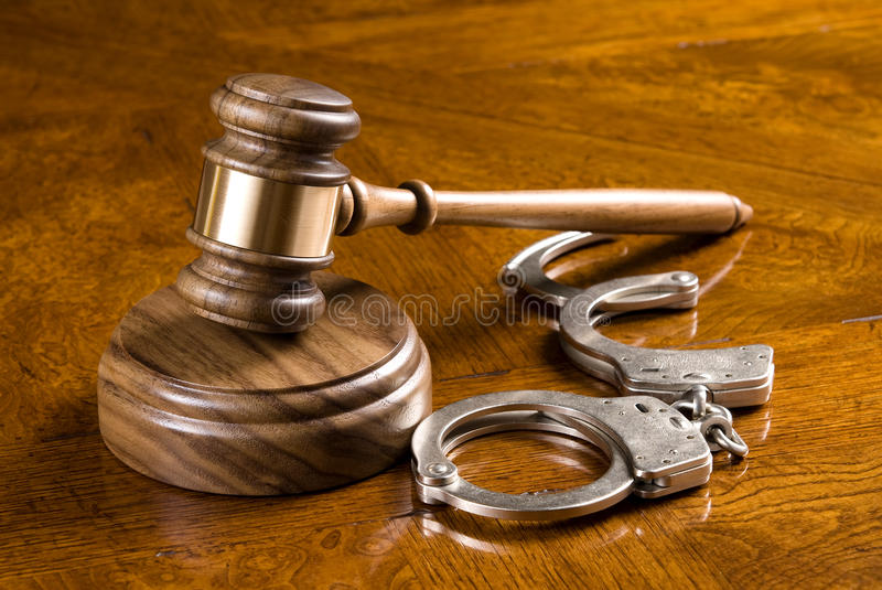 Gavel and handcuffs royalty free stock photos