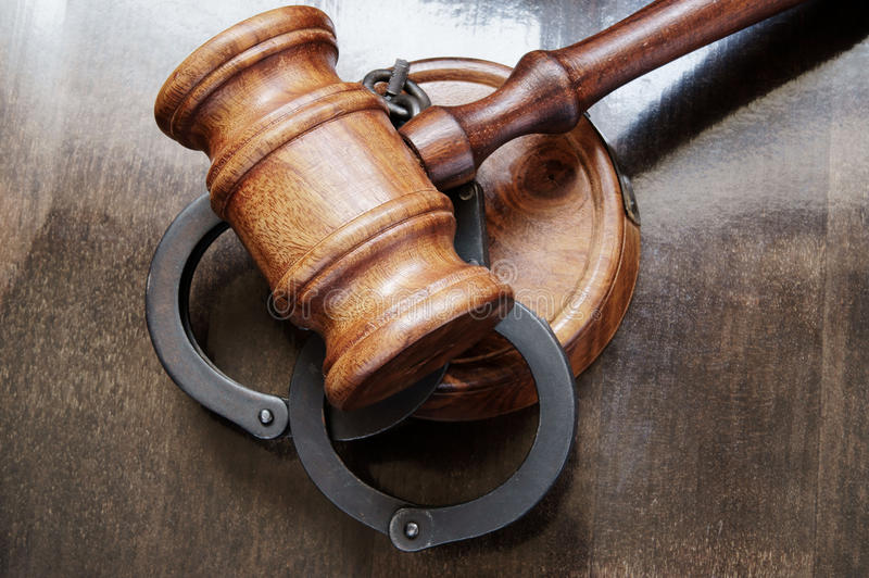 Gavel and handcuffs stock image