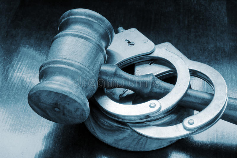 Gavel and handcuffs royalty free stock images