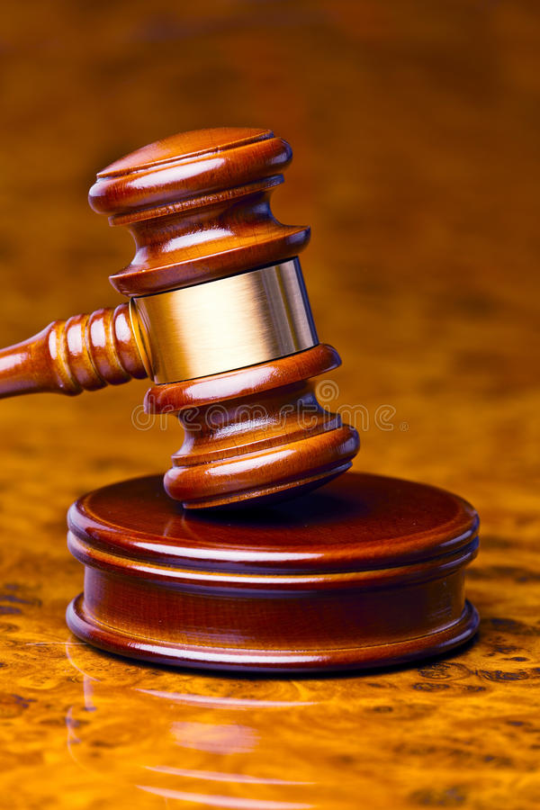 Gavel of a judge in court. The gavel of a judge in court. lies on a desk stock images
