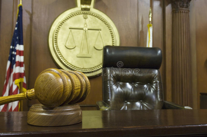 Gavel And Judge's Chair In Courtroom stock images