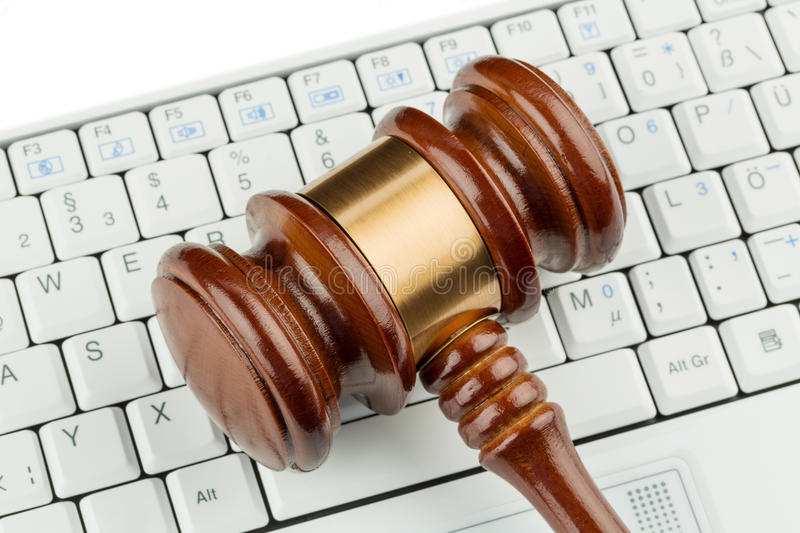 Gavel on keyboard. Gavel on computer keyboard, symbolic photo for e-commerce and consumer protection stock photos