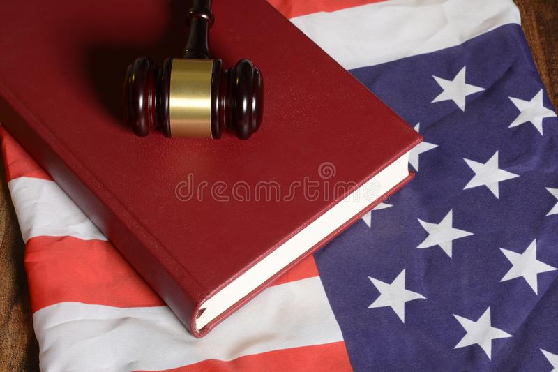 Gavel with law book on American flag.  stock image