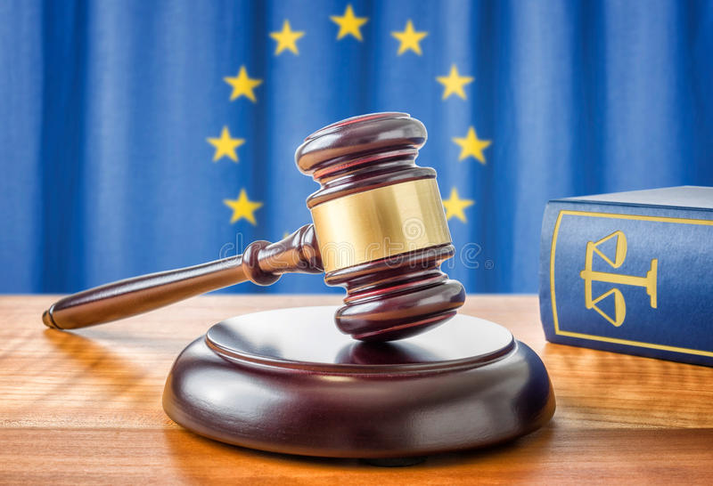 Gavel and a law book - European union. A gavel and a law book - European union royalty free stock photo