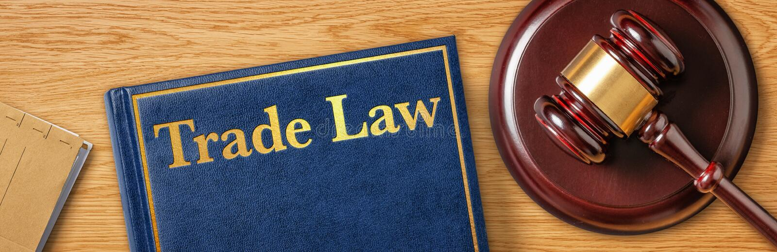 A gavel with a law book - Trade Law stock image