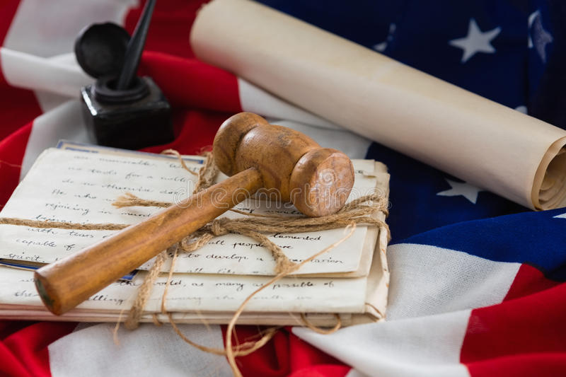 Gavel and legal documents arranged on American flag. Close-up of gavel and legal documents arranged on American flag stock photography