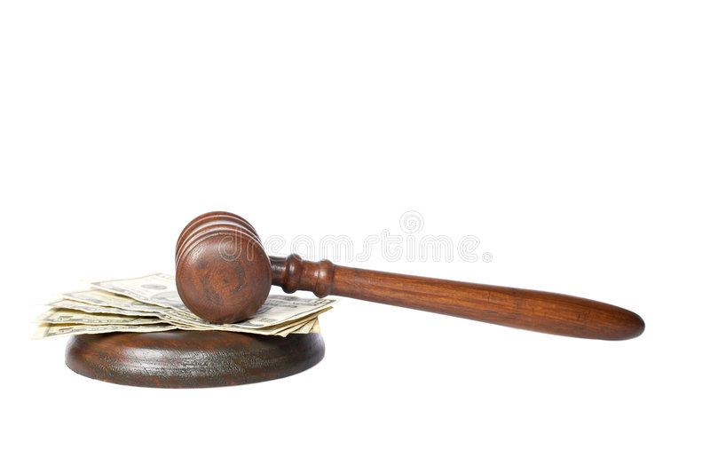 Gavel and money. Wooden gavel and dollars bills from the court isolated on white background stock images