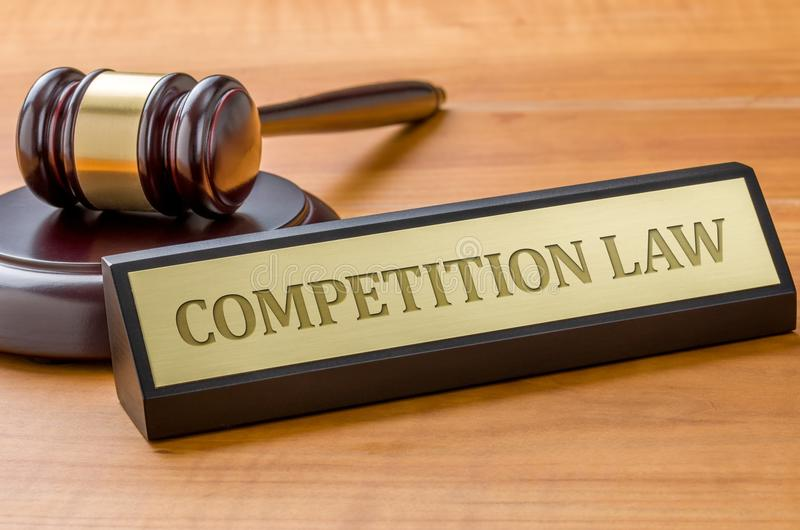 Gavel and a name plate with the engraving Competition law stock photo