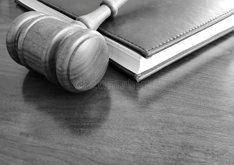A gavel and notebook on a wooden desk. royalty free stock images