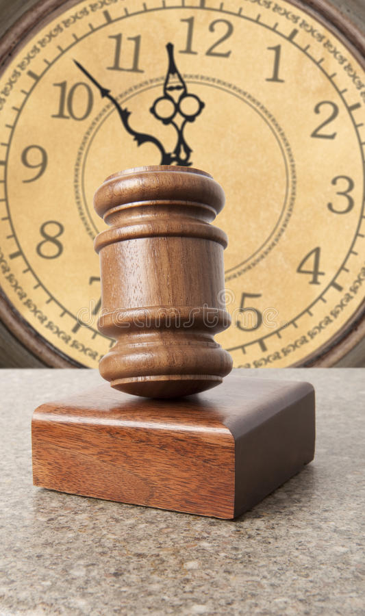 Gavel and old clock stock image