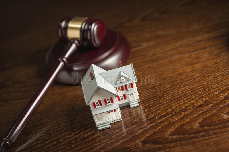 Gavel and Small Model House on Table stock photos