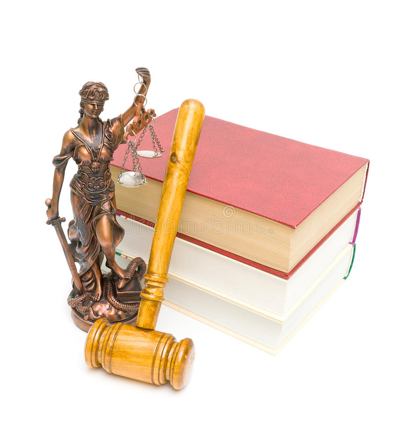 Gavel, the statue of justice and books on white background. Gavel, the statue of justice and books isolated on a white background. vertical photo royalty free stock photos