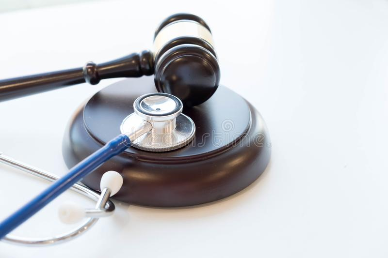 Gavel and stethoscope. medical jurisprudence. legal definition of medical malpractice. attorney. common errors doctors, nurses and. Hospitals make royalty free stock photography