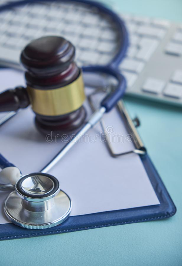Gavel and stethoscope. medical jurisprudence. legal definition of medical malpractice. attorney. common errors doctors. Nurses and hospitals make stock image