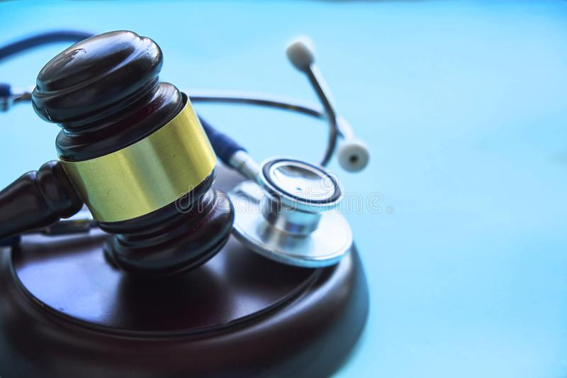 Gavel and stethoscope. medical jurisprudence. legal definition of medical malpractice. attorney. common errors doctors. Nurses and hospitals make stock photos