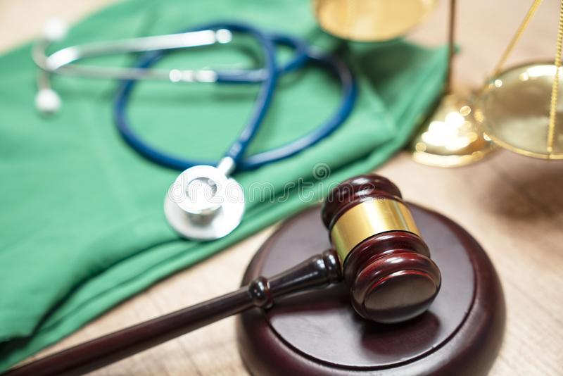 Gavel and stethoscope. medical jurisprudence. legal definition of medical malpractice. attorney. common errors doctors, nurses and royalty free stock photo