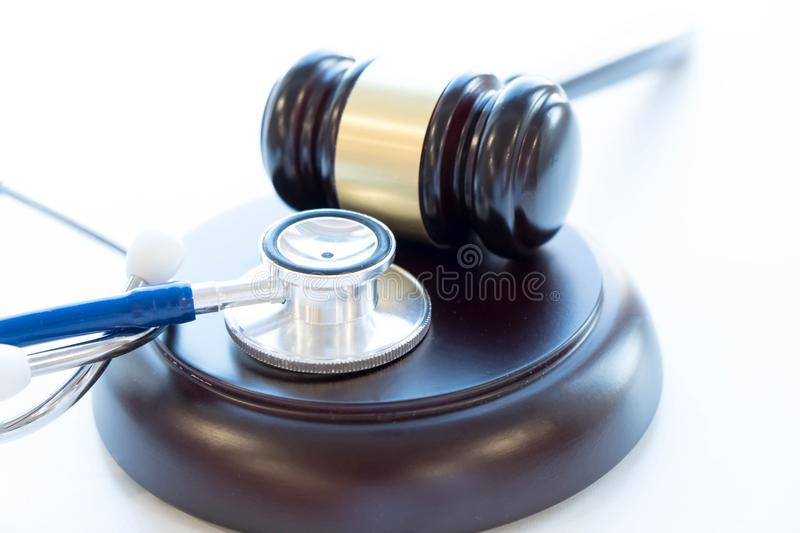 Gavel and stethoscope. medical jurisprudence. legal definition of medical malpractice. attorney. common errors doctors. Nurses and hospitals make royalty free stock photos
