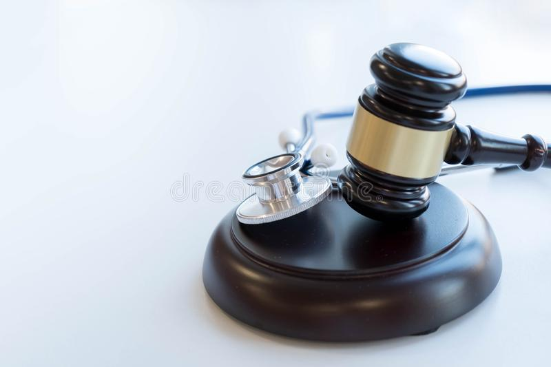 Gavel and stethoscope. medical jurisprudence. legal definition of medical malpractice. attorney. common errors doctors, nurses and. Hospitals make stock photos