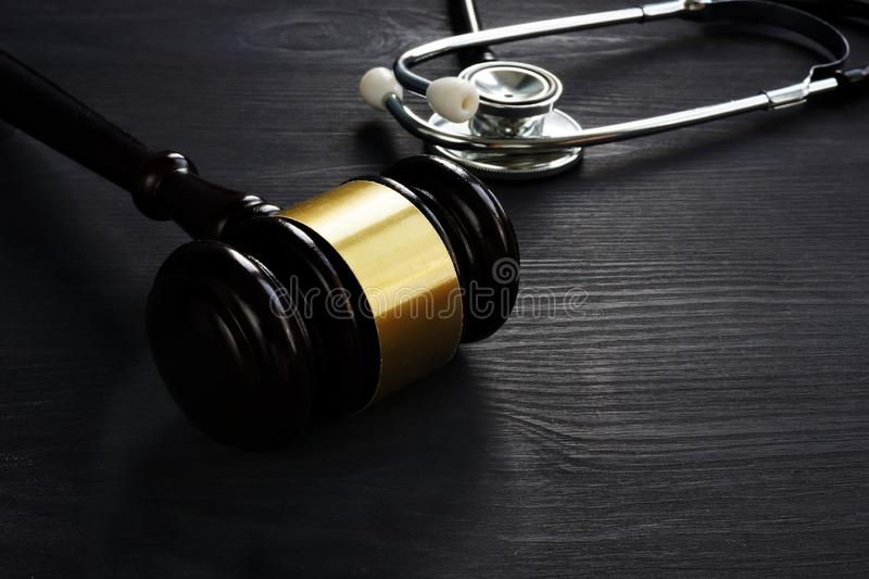 Gavel and stethoscope. Medical negligence concept. Gavel and stethoscope on the wood. Medical negligence concept stock photography