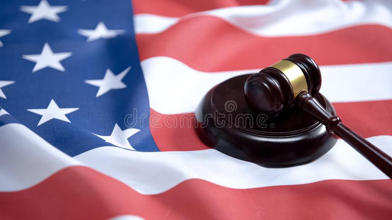 Gavel striking on sound block against american flag, case law, court system royalty free stock photography