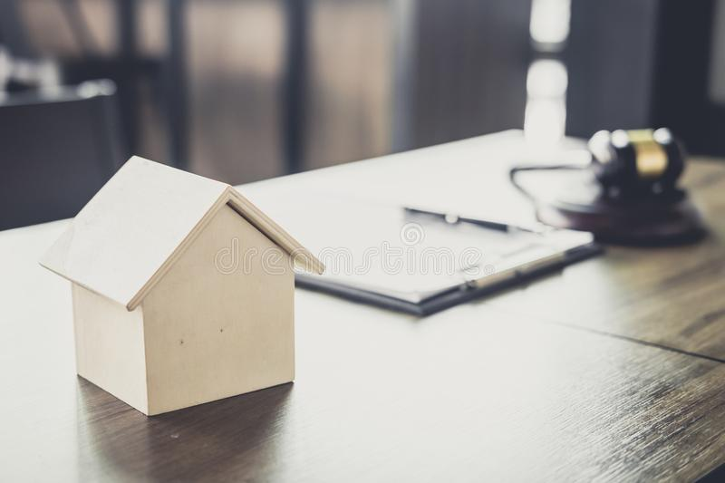 Gavel on wooden table and home loan insurance with agreement in royalty free stock image