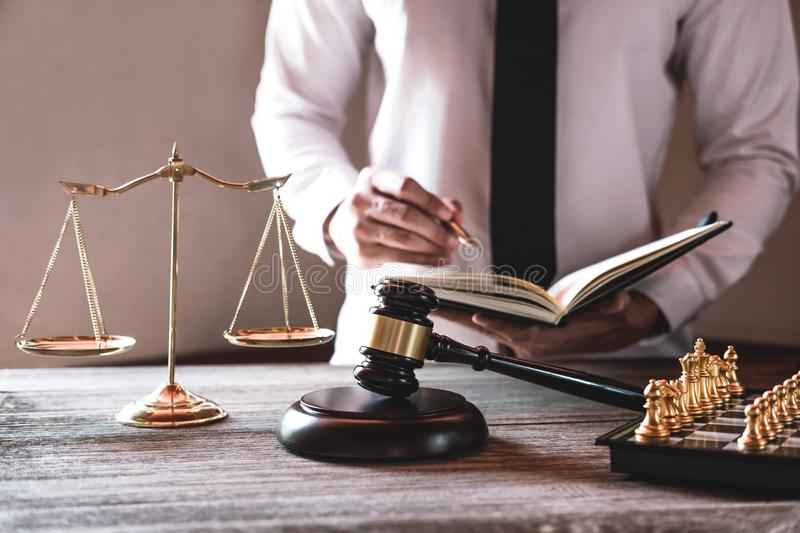 Gavel on wooden table and Lawyer or Judge working with agreement. In Courtroom theme, Justice and Law concept stock images