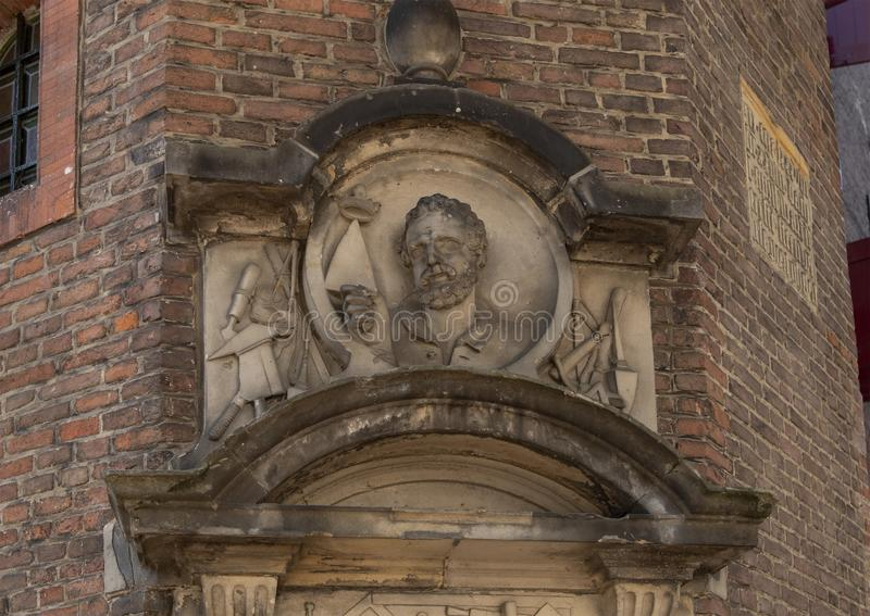 Gavelsten för murarens skrå, Waag byggnad, Amsterdam royaltyfri foto