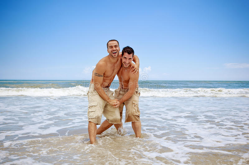 Gay couple. On vacation at the beach