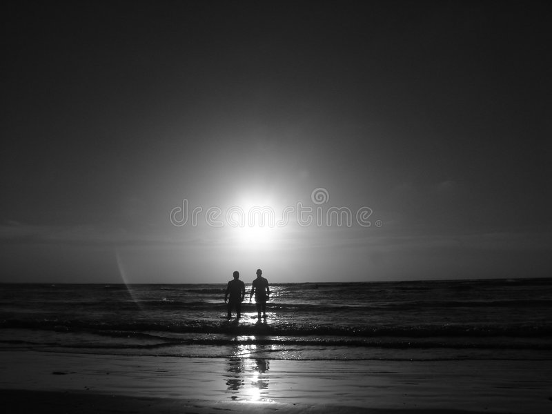 Gay Couple. At the sunset sea