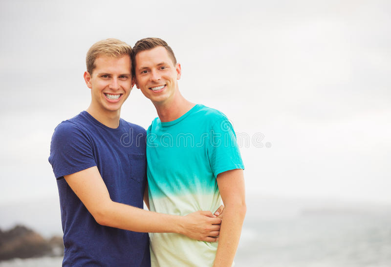 Gay couple on the beach. Happy loving gay couple on the beach royalty free stock photography