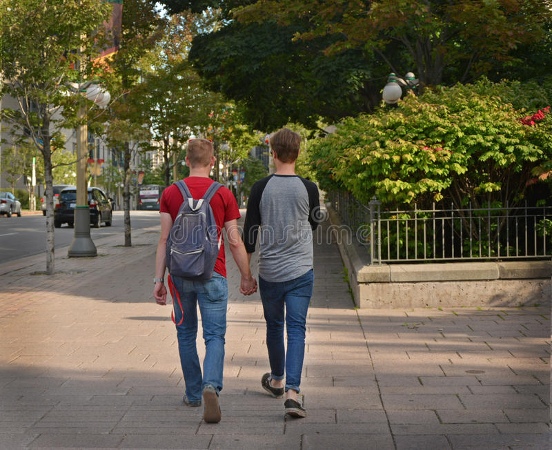 Gay couple in the city. Concept about homosexual, love and lifestyle royalty free stock photography